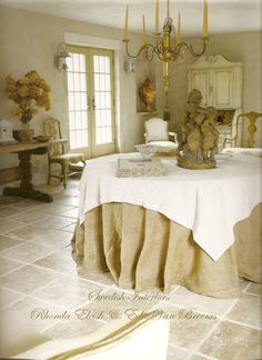 What about covering the kitchen table with a burlap cloth and simple linen overcloth? This room is by Van's daughter Edie van Breems.