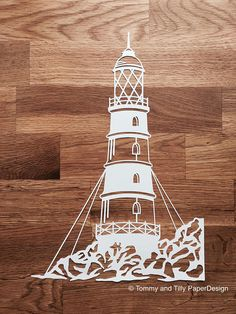 COMMERCIAL USE Lighthouse Papercut Design. Papercutting/Vinyl Template to cut yourself in SVG and PDF format. Small Business Commercial Licence Included!!! *****ITEM DESCRIPTION***** - A perfect design for hand or machine paper cutting! Digitally traced from an original hand-drawing. - This item is a digital file, no physical item will be mailed. Once payment is confirmed you can download the files on the Purchases and Reviews section of your account or via the link Etsy will send t...