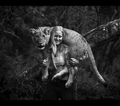 Tamblyn Williams carries six-month-old lion cub Jagger on her shoulders. Jagger arrived at Seaview Lion Park in Port Elizabeth, South Africa, from a different lion park where he was part of a breeding programme. Lion Pictures, Weird Pictures, Amazing Pictures, Lion Tamer, Gato Grande, Amor Animal, Animal Fun, Six Month, Lion Cub