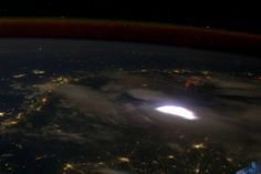 Red sprites, or seemingly mystical electrical flashes in the atmosphere, are connected to thunderstorms and lightning. This red sprite was captured from astronauts aboard the International Space Station traveling southeast from central Myanmar to north of Malaysia on April 30, 2012.