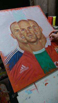 Paul O'Connell painting - some final touches in acrylic paint to highlight certain areas before leaving to dry.