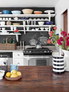 Paint a single wall or your backsplash with chalkboard paint for a playful touch—use the space to write down your grocery shopping list or your weekly to-dos.