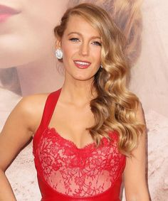 """Blake Lively hair: Then wrap 1/2"""" sections around curling wand, all in the same direction. Once cooled, flip head upside down and fully brush out the waves with a large paddle brush. Moving on to the hair on the other side, French-braid a section toward the back of the head, using bobby pins to secure in place. Top with hairspray."""