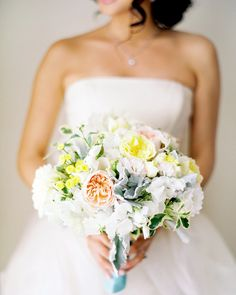 The bride carried a bouquet of garden roses, dahlias, sweetpeas, feverfew, variegated Italian pittosporum, and dusty miller. It was created by Nancy Liu Chin of Nancy Liu Chin Designs.