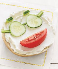 Bagel and Cream Cheese With Tomato and Cucumber...Liven up a boring breakfast by creating faces out of healthy ingredients. Better yet, give the little ones an assortment of vegetables and let them play with their food.