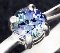 TANZANITE SILVER RING SIZE 7 FACTORY DIRECT4 [SJ2131]  This is a natural stone from Tanzania which has been heated to improve its colour  Ring size: 7 USA  Prong set  Quality workmanship.  Silver stamped 925  Weight stone 0.55 cts app  Weight of silver used  2.08 grams  app   Size of stone  5 x 5 mm app