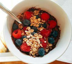 Muesli raspberries blueberries chocolate