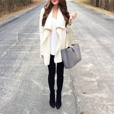Click the photo to shop the look | Southern Curls and Pearls wearing a cream open cardigan, Saint Laurent grey bag, and suede black boots | Follow @liketoknowit on Pinterest for more outfit inspiration #liketkit