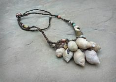 a beachcombers pocketful..  necklace    my process is going through some mutations.. my tailoring past coming in to play  building forms by thousands of sewn stitches.. this opens up my scope for shape.. more sculptural.. and the transition is exciting for me  just over 100 hrs spent lost in the world of my fingertips in here  a handful of shells beachcombed with delight.. a few pieces of buttery raw skye marble, brought back to the studio in pockets.. steam cleaned filed filled and…