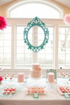 Pretty dessert bar with aqua blue and pinks.