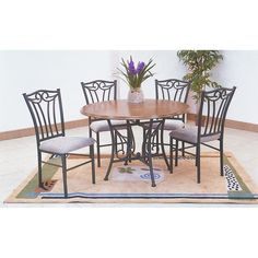 5pc Black Metal & Wood Round Dining Room Table & Chair Set - Table features a round wood top finished off in warm oak, Table base is crafted in metal for ultimate durability. Simple yet classically designed for small family and can be placed in a wide variety of home designs.