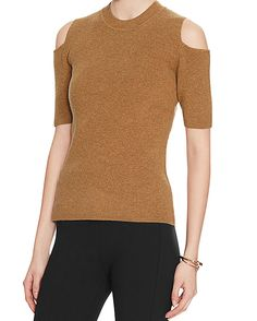 Exclusive for Intermix Cold Shoulder Knit Top: Burnt Orange: Cut aways at the shoulders reveal just the right amount of skin. 3/4 length sleeves. In burnt orange.  Fabric: 90% wool/10% cashmere Made in China. Model Measurements: Height 5'10 1/2; Waist 24 ; Bust 31 wearing size S Length from shoulder to hem: ...