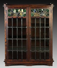 """LIMBERT TWO DOOR BOOKCASE. Rare and early quarter sawn oak, key & tenon.  Leaded & stained glass doors. #331 on reverse. Original finish. Original ironwork. Dimensions: Ht. 54"""" W 41"""" D 14"""""""