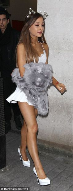 Bit chilly: Ariana looked more like she was attending an exotic beach party than a radio i...