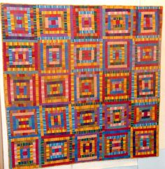 """Stripe It Rich"": Kaffe Fassett stripes log cabin quilt at Waterwheel House Quilt shop (Vermont).  Published in Quilt Sampler Fall/Winter 2012"