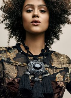 """vogue:  Game of Thrones's Nathalie Emmanuel uses jewelry to  make things interesting—""""for hints of sparkle,"""" she says. See 8 more statement pieces on Vogue.comPhotographed by Gregory Harris, Vogue, July 2015"""
