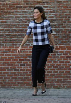 Monochrome magic: Queen Letizia of Spain was tailored to perfection on Thursday when she stepped out in a smart monochrome ensemble in Madrid