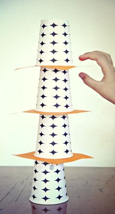 Yank Me game with cups. A fun boredom buster for kids that will keep them occupied for a while