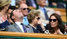 The Duchess of Cambridge was among the famous faces watching at Centre Court today and looked determined not to let the rain get her down