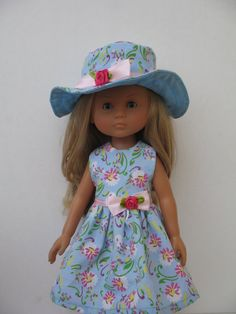 This doll dress fits Les Cheries Corolle doll(13/33cm.)and Paola Reina doll(32 cm.).It is a lovely printed cotton fabric.It looks very cute on