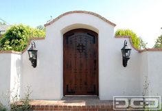 A Laguna Beach, CA Spanish Colonial Gate Handcrafted in Rustic Alder Wood traditional front doors