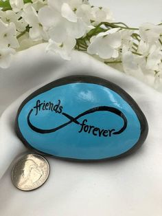 Friends Forever! Show your love and appreciation for your lifelong friends with this river rock painted with the infinity symbol. Available in blue or tan background (make your selection with the drop-down menu). Sizes and shapes of the stones will vary, but most measure around 3.5 x 2.