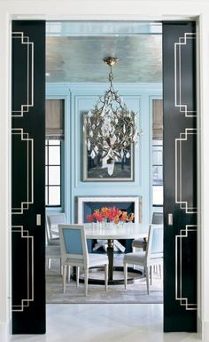 House Porn. I LOVE this.....turquoise, the chandelier (which usually isn't at all my taste, but works so well here) and the black doors, oh my....gorge!