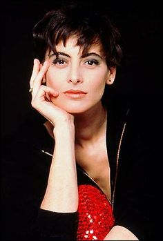 ines de la fressange.  She is a major reason why I favor simple clothes, bohemian blouses, funky jewelry, and straw handbags (especially in the summer).  And flats.