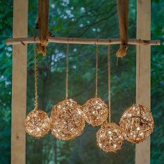 DIY Outdoor Chandelier - This outdoor lighting craft features glowing grapevine balls that create a pretty glow.