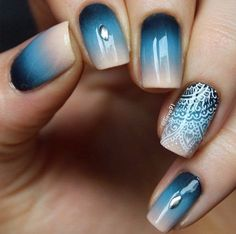 Nail design using: white and gold on dark blue, light blue and beige