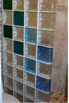 Learn how colored glass blocks and durable materials added style and function to a small 32 x 60 shower remodel in New Mexico. #glassblockshower #3260shower #coloredglassblock http://blog.innovatebuildingsolutions.com/2014/10/11/colored-glass-block-wall-stylish-durable-alternative-los-alamos-mexico-shower-remodel/