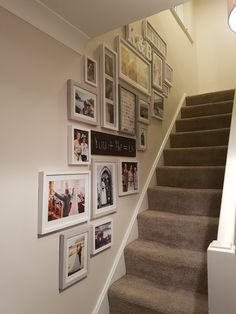 Our photo wall going up the staircase! picture wall, picture gallery