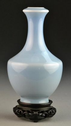 """Chinese Qing Clair de Lune Porcelain Vase. Of unusual shape with fine glaze, raised on hardwood stand, the base bearing six character Qianlong mark in underglaze blue but probably 19th century, vase measures 7.5""""H without stand. Private collection, West Bloomfield Michigan."""