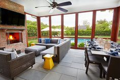 With a fireplace and views of the grounds, this screened porch is perfect for late night hosting and parties. Outdoor Decor, House, Spacious Kitchens, Porch Fireplace, Contemporary Decor, Home Decor, Screened Porch, Spacious, Fireplace