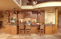#Kitchen Idea of the Day: A nautical themed kitchen under a loft, featuring a large kitchen island and a wood hood with a lobster carving! Unique Kitchens. (By Crown Point Cabinetry)