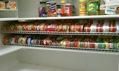 My gravity can rack - used two 4' wire closet shelves ($12 ea at walmart) and flipped upside-down. raised in the back and supported on screws. top one has screws on the side to support it. maximizes the use of the pantry space without cans toppling all over the place! great pantry organization project.