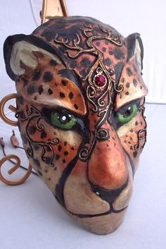 A cheetah mask I made. Cats are fun to do! I'm particularly happy with the gold tree design and the gem in the middle. This one is still up in my etsy shop.