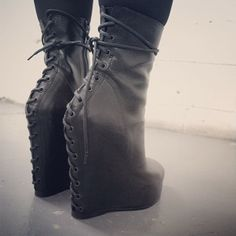 Lace up boots very goth military like I love these
