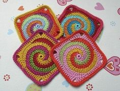 Spiral Granny Square - CafeMom:  Not sure, but this just looks like a starting chain round followed by connected single or double crochet chains with a border to bring them all together.  I may have to play around with this to figure out the pattern. LOVE IT.