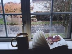 Coffee, a good book, a fresh breeze of some crisp autumn air, a sweater and some furry slippers. <3