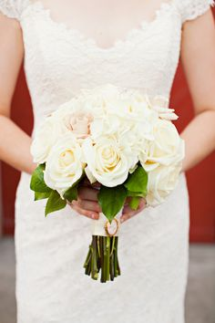 Classic white rose bridal bouquet from the Enchanted Florist, photo by Rachel Moore