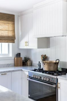 Last month, I was incredibly proud to share our home outdoor makeover collaboration with Pottery Barn, featured in the first issue of their new publication, The Collected Home. White Shaker Kitchen, All White Kitchen, White Kitchens, Faux Wood Blinds, Bamboo Blinds, Modern Farmhouse Kitchens, Modern Farmhouse Style, Wall Cladding Panels, Wall Panelling