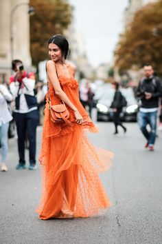 How darling is this Paris Fashion Week outfit? We love the ruffles and bright orange color! This dress is super fun and giving us major ootd goals!