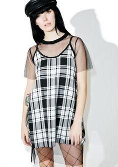 The Ragged Priest Outbreak Dress wants you to break outta yer shell bb. This sik af dress features a tartan plaid spaghetti dress with a midi mesh overlay, all in a relaxed fit.