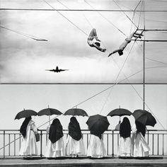 6umbrellas and an airplane circus act.