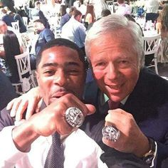 Kraft and Butler showing off their Super Bowl rings.