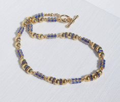 Sapphire blue crystal and gold necklace by ParkhillDesigns on Etsy