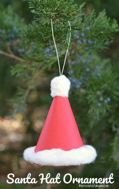 This Paper Santa Hat Christmas Ornament is an inexpensive and easy craft that kids can make and hang on your Christmas tree and enjoy for years to come. 3D ornament #christmas #christmasornaments #KidsCraft