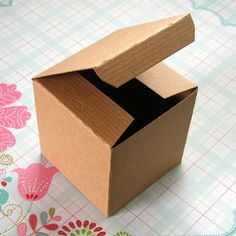 10 Kraft Boxes Pinstripe 3 x 3 x 3 inches. $4.25, via Etsy.