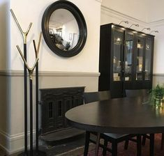 Convex and round mirrors over a fireplace visually break up the straight lines of a mantlepiece, making them the perfect overmantle mirror for your home. Convex Mirror, Round Mirrors, Mirror Over Fireplace, Fireplace Ideas, Oversized Round Mirror, Overmantle Mirror, Office Interiors